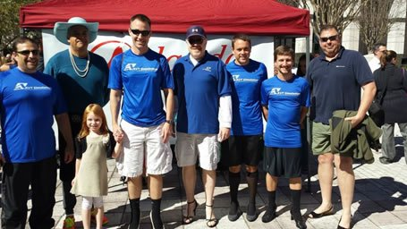 Walk a Mile in Her Shoes AVT Team group shot red tent