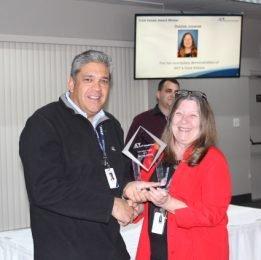 Robert abascal awarding Debbie Jozwiak AVT